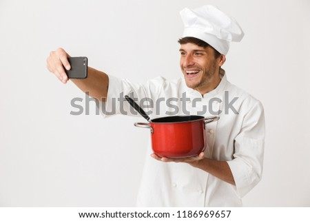 chef man isolated over white wall background take a selfie by mobile phone stock photo © deandrobot