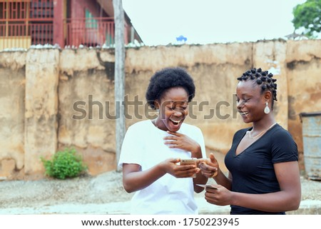 Joyous african american woman smiling and holding credit card, i Stock photo © deandrobot