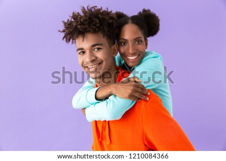 Photo of excited african american brother piggybacking his joyfu Stock photo © deandrobot