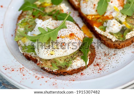 Sandwich with open poached egg and pepper on a plate and coffee  Stock photo © dashapetrenko