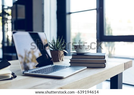 modern office place with comfortable office workspace   computer desk orthopaedic chair and right a stock photo © artjazz