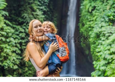 Anya fiú vízesés Bali sziget Indonézia Stock fotó © galitskaya