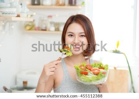 Beautiful Young Woman eating fresh vegetable salad. Loosing Weight concept Stock photo © galitskaya