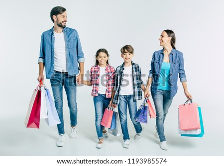 Portrait full length of happy woman holding paper shopping bag over shoulder, posing and smiling at  Stock photo © studiolucky
