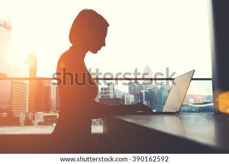 Woman designer sitting in office working reading book at night. Stock photo © deandrobot