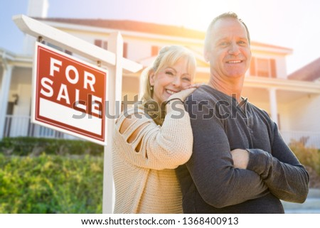 Attractive Middle-aged Couple In Front House and For Sale Real E Stockfoto © feverpitch