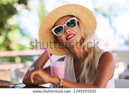 A fashion and lifestyle concept - beautiful woman in hat enjoying summer outdoors. stock photo © ElenaBatkova