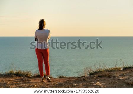 красивая · девушка · синий · свитер · джинсов · портрет - Сток-фото © elenabatkova