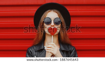 Beautiful young woman blowing a kiss from her hand. Model with p Stock photo © serdechny