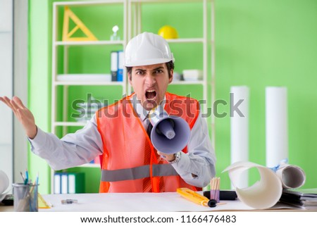 Construction supervisor with loudspeaker sitting in the office  Stock photo © Elnur