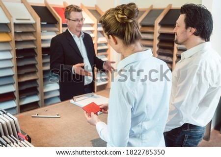 Woman, man, and expert discussing details of new kitchen finish Stock photo © Kzenon