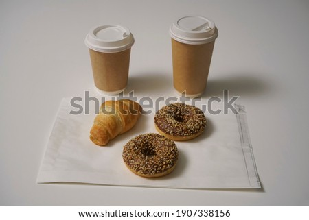 croissants glazed cookies and a cup of coffee on a white wooden table stock photo © katya_sorokopudo