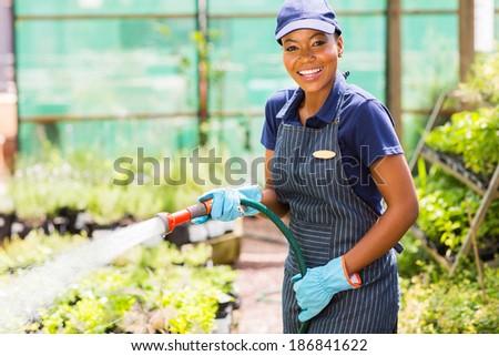 Genç Afrika kadın sera işçi ayakta Stok fotoğraf © pressmaster