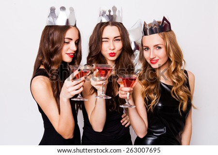 Three young elegant friends cheering up with champagne during celebration Stock photo © pressmaster