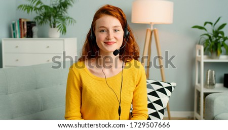 Image of cheerful redhead businesswoman watches webinar or tutorial video, uses free internet connec Stock photo © vkstudio