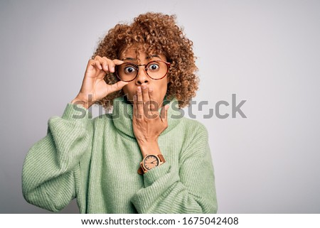 Secret woman with curly hair, covers eyes, wears spectacles, waits for surprise, dressed in black ca Stock photo © vkstudio
