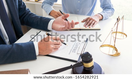 Male lawyer or judge consult with client check contract papers r Stock photo © snowing