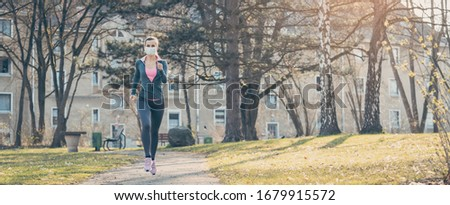 Woman jogging down a path boosting her immune system for covid-19 Stock photo © Kzenon