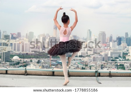 Pretty young ballerina dancer dancing classical ballet against r Stock photo © boggy