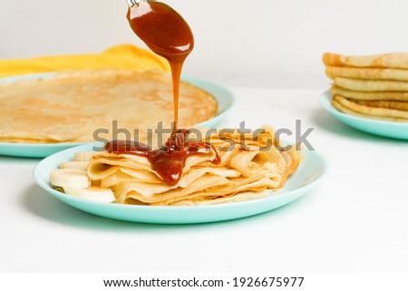 Caramelized sugar levitates on a white background Stock photo © butenkow