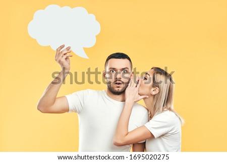 Młoda kobieta tajniki człowiek papieru bubble myśl Zdjęcia stock © GVS