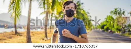 Mask corona virus COVID-19 running runner athlete wearing mask jogging outside on run workout in sum Stock photo © Maridav