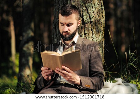 business person eating lunch outside office and reading papers stock photo © diego_cervo