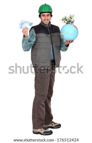 construction worker standing with cash and a globe with green shoots stock photo © photography33