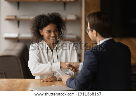 Satisfied manager interviewing a female applicant in his office Stock photo © wavebreak_media