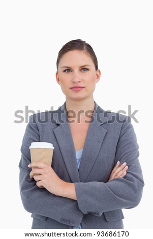Tradeswoman with arms folded and paper cup against a white background Stock photo © wavebreak_media