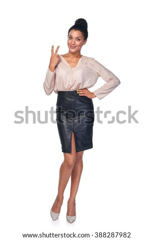 Portrait of confident young business woman showing victory gestu Stock photo © HASLOO