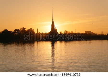 Peter and Paul Cathedral in Saint-Peterburg on an orange backgr Stock photo © mayboro