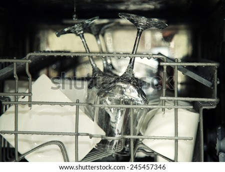 details of open dishwasher, utensils with drops in during washin Stock photo © vladacanon