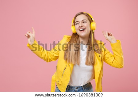 music and technology concept - young woman listening to music and show on her headphones, isolated o Stock photo © id7100