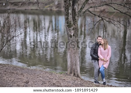 Man and woman in early fall park. man is embracing smiling woman and looking at her Stock photo © Paha_L