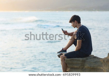 Casual man texting message on smartphone, morning sunlight throu Stock photo © stevanovicigor