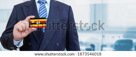 credit card with uganda flag background for bank presentations and business isolated on white stock photo © tkacchuk