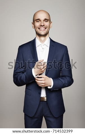 Cheerful Businessman Fixing Cuffs his Suit Stock photo © filipw