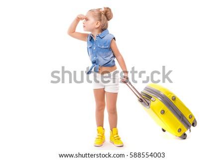 Güzel küçük kız sarı gömlek beyaz şort Stok fotoğraf © Traimak
