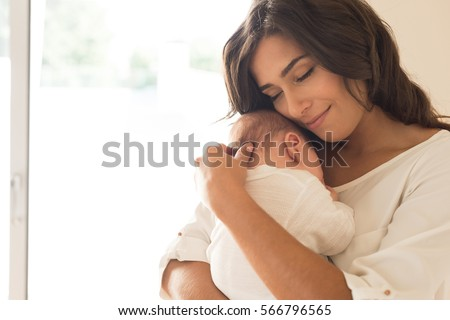 young mother holding her newborn child mom nursing baby family stock photo © dashapetrenko