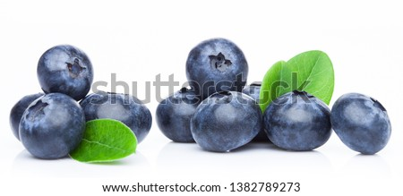 Fresh raw organic blueberries with leaf in vintage wooden box on stone kitchen background. Macro Stock photo © DenisMArt