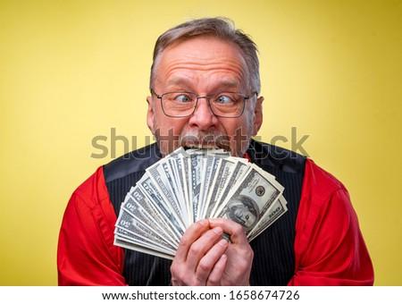 бизнесмен черный костюм стороны доллара валюта Сток-фото © ia_64