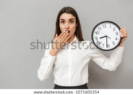 Photo of businesslike happy woman in white shirt and black skirt Stock photo © deandrobot