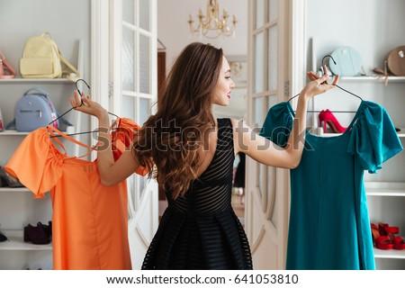 красивая · женщина · торговых · одежду · магазине · женщину · одежды - Сток-фото © dolgachov