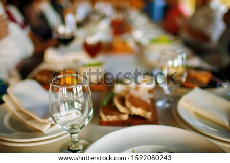 people at the table at a solemn event clink glasses and celebrate Stock photo © ruslanshramko