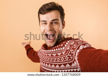 Image of handsome man 20s with stubble wearing knitted sweater u Stock photo © deandrobot