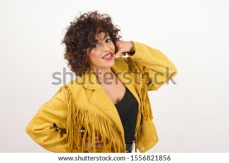 Fashionable brunette imitating conversation of call phone with shoe. stock photo © studiolucky