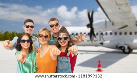 friends pointing at you over plane on airfield Stock photo © dolgachov