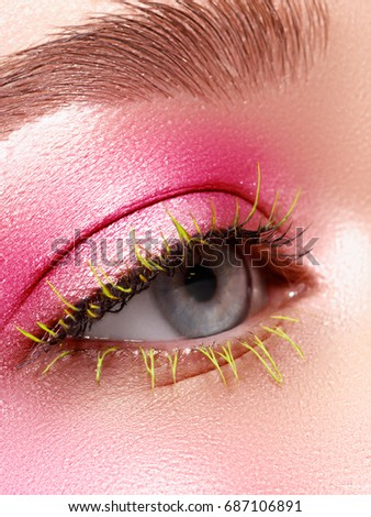 Creative Makeup. False long gteen eyelashes closeup. Beauty model woman face make-up with fantasy br Stock photo © serdechny