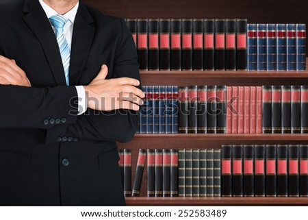 Close-up of Male lawyer with arm crossed standing front backgrou Stock photo © Freedomz